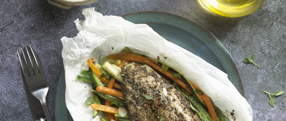 Baked cod parcels with olive tapenade and mixed spaghetti vegetables