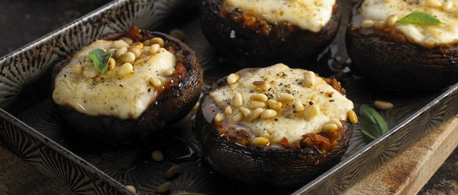 Baked mushrooms with sun dried tomato paste and goats' cheese